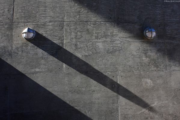 Concrete wall, a couple lights and the shadow.